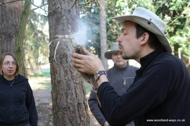 Survival school teaching how to light fire