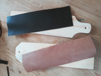 Lay the wood on the smooth leather and draw round it