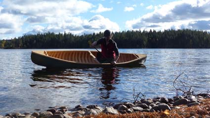 Paddling the wood and canvas canoe in the Swedish woods.