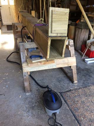 Improvised wood steamer using a plank wood box and a wallpaper steamer.