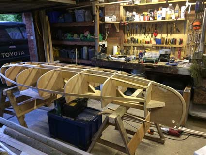 Installing stem pieces attached to their molds forming the bow and stern of the canoe mold.