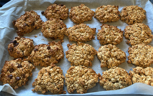 A full tray of chocolate chip and plain honey oat biscuits